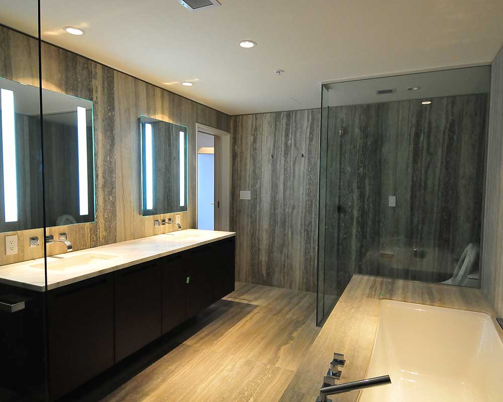 marble bathroom counters and bathtub surround